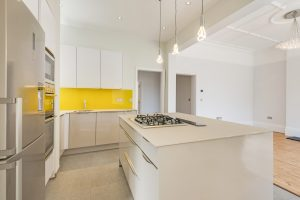Kitchen refurbishment, glass work surfaces and splash back, feature island