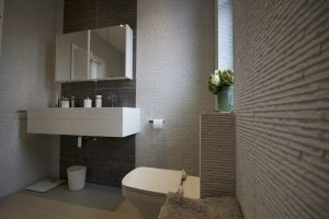 Bathroom in a large loft extension which involved raising the height of the roof